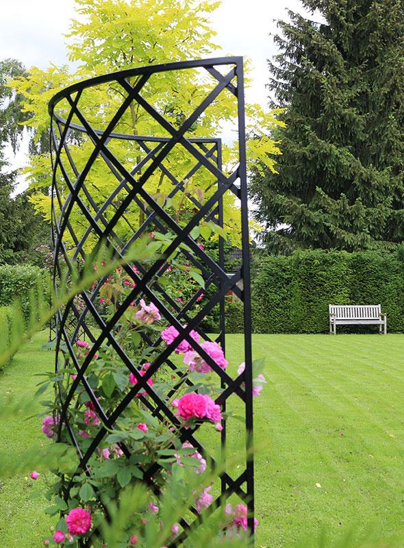 Exedra freestanding halfround metal garden trellis with roses in park