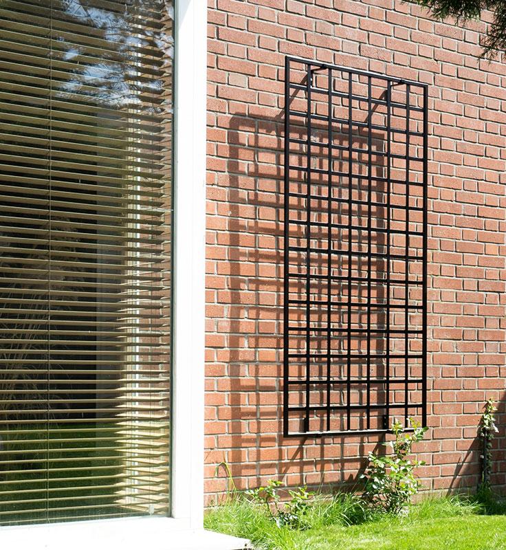 wall mounted modernist trellis on clinker brick facade