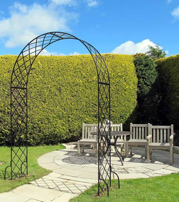 Bagatelle Round Top Garden Arch framing the way to a patio