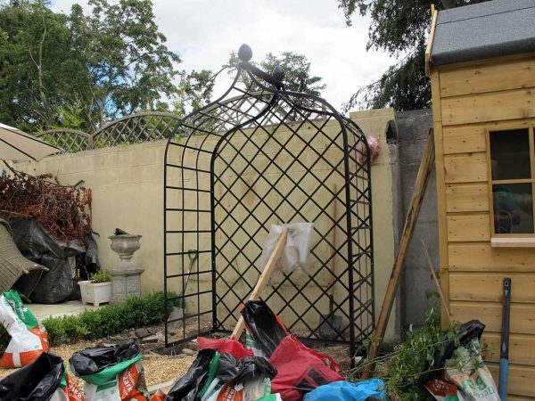 Installing the metal Victorian Rose Arbour 4