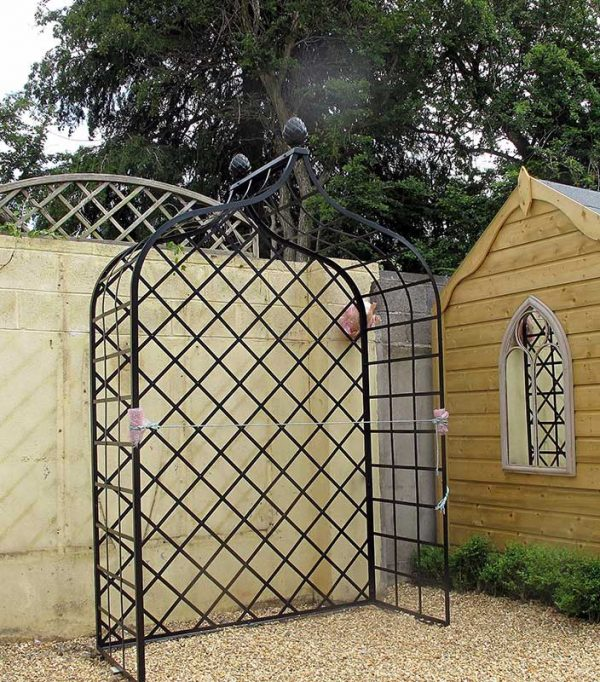 Installing the metal Victorian Rose Arbour 5