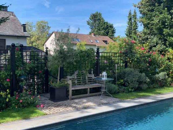BAUHAUS metal railing panels frame a pool