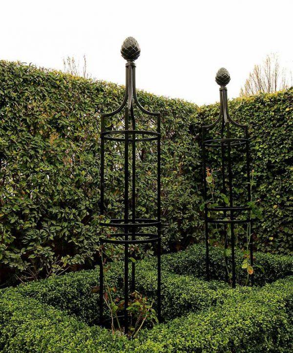 Formal border with Metal Garden Obelisk I