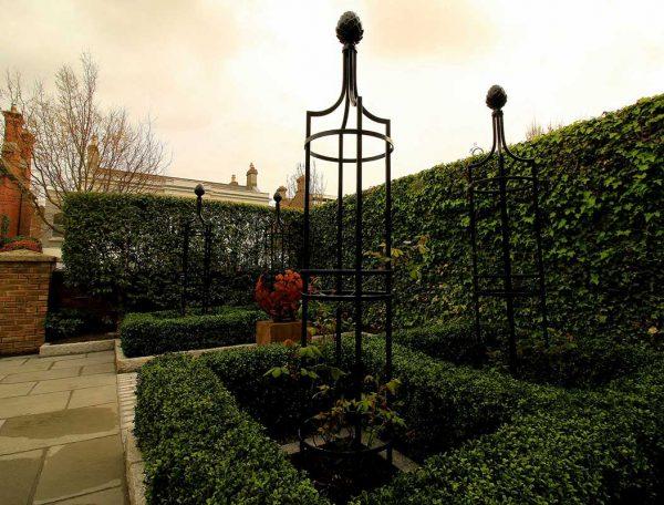 Metal Garden Obelisk I in a patio setting