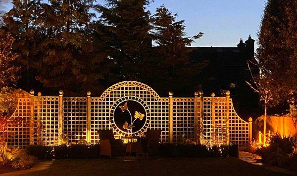 The Trianon Rose Treillage Set illuminated